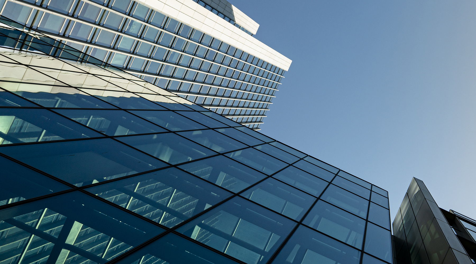 Modern city building architecture with glass fronts on a clear day in London, England panoramic
